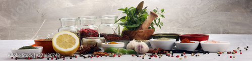 Spices and herbs on table. Food and cuisine ingredients with basil