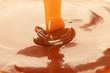 Pouring delicious caramel sauce as background, closeup