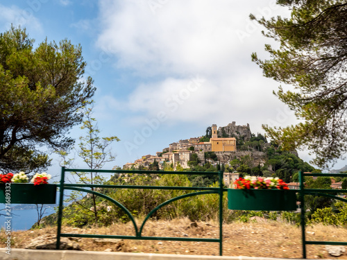 driving and passing by the village of Sainte Agnes in French Riviera in summertime