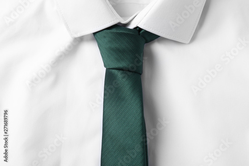 Tableau sur Toile Color male necktie on white shirt, closeup