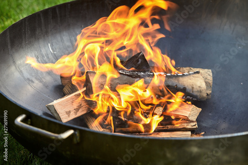 Valokuvatapetti Logs on fire covered in burn marks during cookout