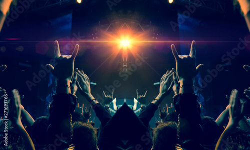 Concert spectators in front of a bright stage with live music - 271693766