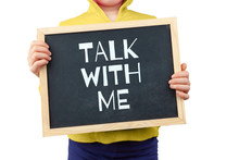 Communication With Children Issue Depicted With Child Holding Blackboard With Text Saying Talk With Me
