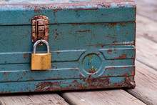 Rusty Old Toolbox Locked Up Sitting On A Wood