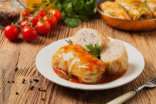 obraz dibond Traditional stuffed cabbage with minced meat and rice, served in a tomato sauce.