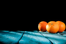 Fresh Orange Juice On Blue Wooden Board And Fresh Fruits