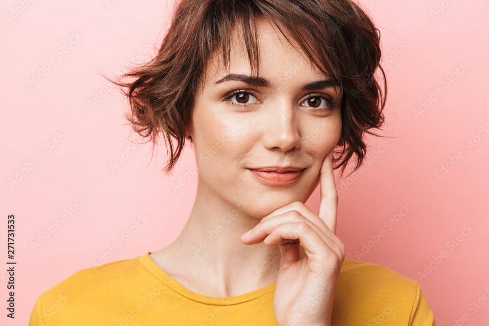 Fototapeta Happy beautiful woman posing isolated over pink wall background.