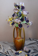 Beautiful Vintage Still Life In Dark Tones From A Bouquet Of Yellow-brown Iris Flowers In A Brown Vase-amphora On A Coffee And Chocolate Background