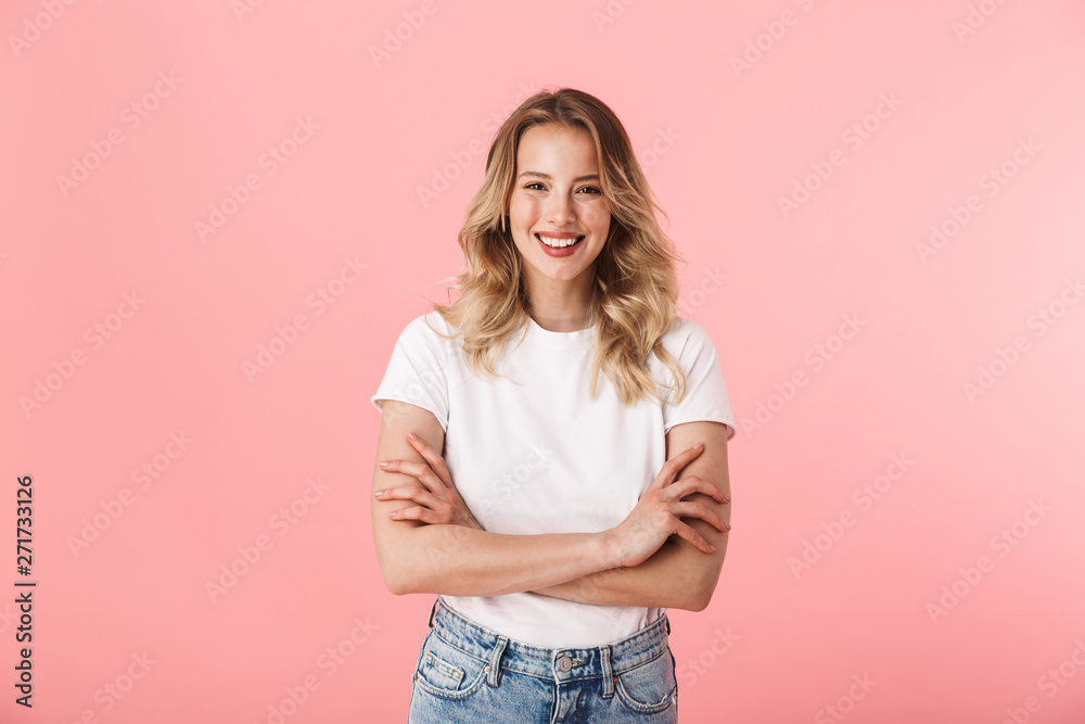 Fototapety, obrazy: Beautiful young blonde woman posing isolated over pink wall background.