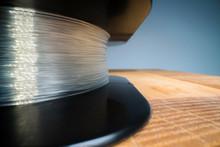 Macro Shot Of Fishing Line Spool Texture. Monofilament Line Wrapped On A Black Spool. Fishing Gear