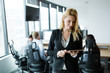 Leinwandbild Motiv Attractive businesswoman using digital tablet in office