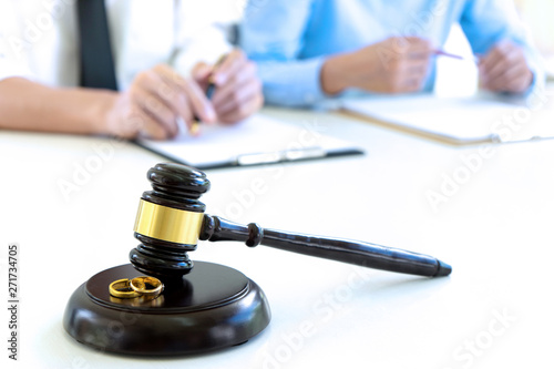 woman and man quarrel in front of gavel