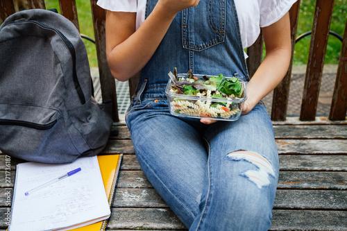 Teenage student having healthy lunch