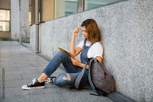 Student girl studying sitting on the floor