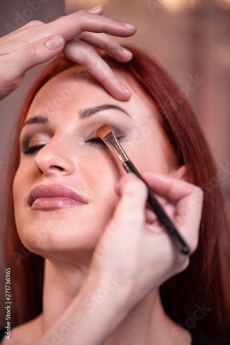 17a4bc7b1d9 Closeup Of Beautiful Young Woman Face With Beauty Makeup, Fresh Soft Skin  And Long Black Thick Eyelashes Applying Mascara With Cosmetic Brush.