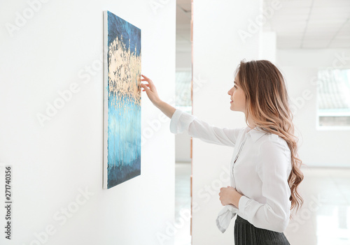 Woman at exhibition in modern art gallery Wallpaper Mural