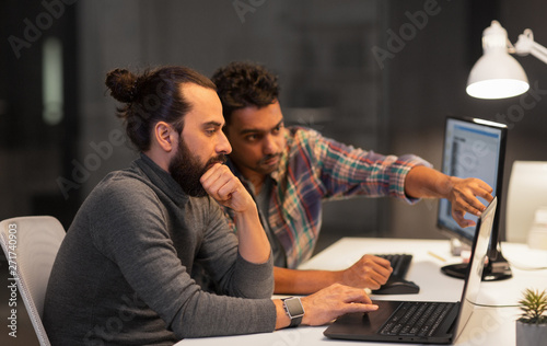 deadline, technology and people concept - creative team with laptop computer wor Wallpaper Mural