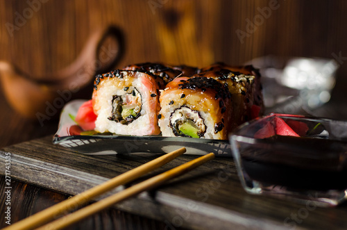 Photo Stands Sushi bar sushi rolls with red fish