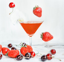Refreshing Healthy Drink With Chia Seedsand Falling Strawberries And Cherries. The Atmosphere Of Summer And Relaxation. Proper Nutrition.