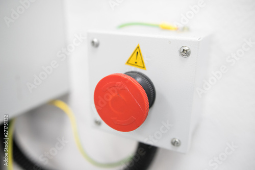 Poster Macarons Red button. Big red button on wall. The Production emergency button pushing. Red emergency shutdown button