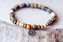Mineral Stone Tyger Eye Bead Bracelet On Natural Wooden Background