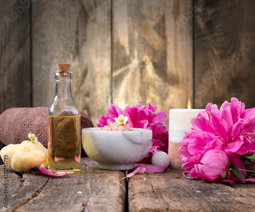 spa massage setting, lavender product, oil on wooden background, Vlaentine day background