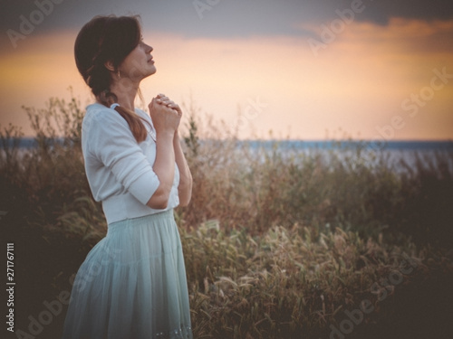 Silhouette Profile Of A Beautiful Girl In A Dress Praying To God In The Field A Young Woman Walking On Nature During Sunset Looking Up Into The Sky Religion Concept Buy