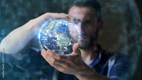 Portrait of an young man is using the futuristic latest innovation technology with augmented reality hologram Fototapet