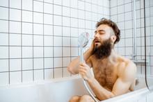 Joyful Bearded Man Washing In ...