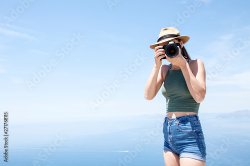 beautiful young photographer taking a photo