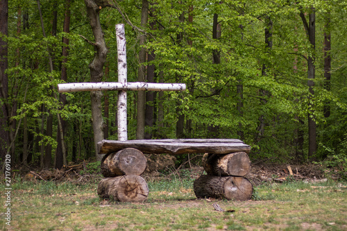 Canvas Print A wooden altar and cross in a forest.