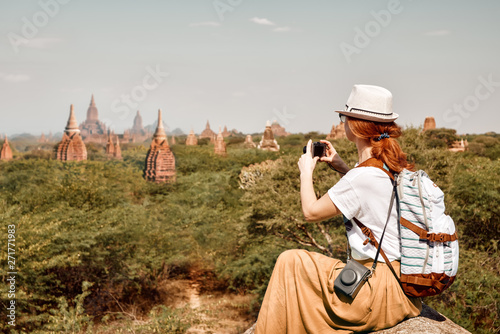 woman traveler with backpack enjoying the view in Bagan, Myanmar Asia.