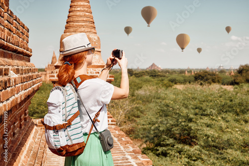 Young female traveler with backpack enjoying the view in Bagan, Myanmar Asia.