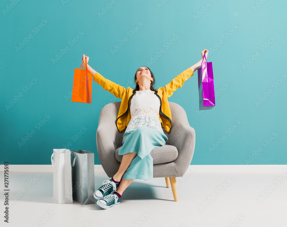 Fototapety, obrazy: Cheerful shopaholic woman with shopping bags