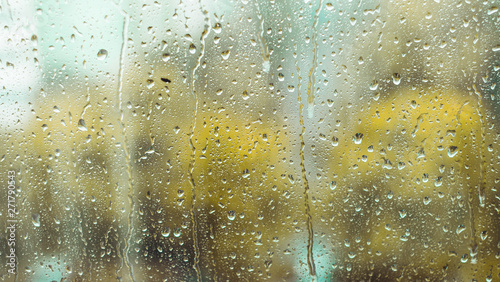 Foto auf Leinwand Wasserfalle rain drops on the window. rainy window in autumn. abstract view.