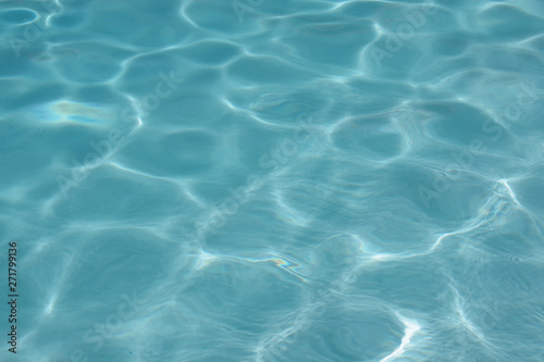 Close up full frame view of the reflecting water surface of a sunlit swimming po Canvas Print