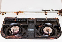 Closeup Of Two Small Old Rusty Vintage Gas Stove Top Outdated White Countertop In Retro Kitchen In Country House