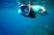 Woman Swim In Blue Sea. Girl Snorkeling In Full-face Mask. Snorkel Closeup Underwater Photo. Snorkeling Mask Undersea