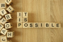 Text It Is Possible From Wooden Blocks On Desk