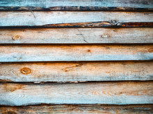 Pine Plank Fence. Background Of Pine Old Natural Wood Planks. Close-up, Light Yellow Rough Surface Of A Sawn Log Of A Dry Pine Tree.
