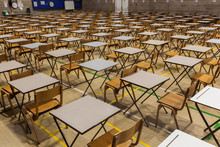 Exam Tables Set Up In A Sports Hall For Exams In A High School & Sixth Form