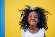 Cute Mixed Race Girl Having Fun At Street. Child Innocence Concept.