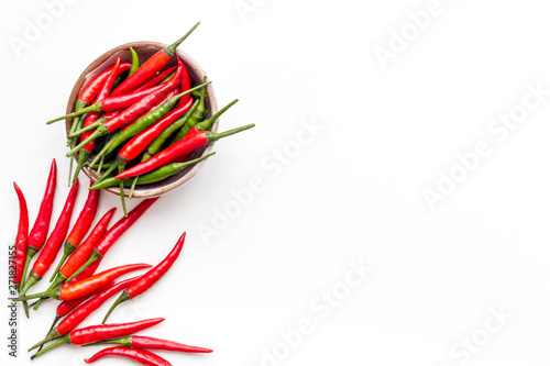 Foto auf AluDibond Hot Chili Peppers Fresh red and green chilli pepper as food ingredient on white table background top view mockup