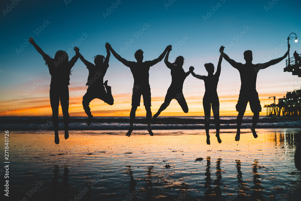 Fototapety, obrazy: Silhouette of jumping friends enjoying summer vacations and youth lifestyle during scenery sunset, group of people holding hands and feeling happiness about friendship. Concept of friendship, success