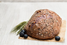 Blueberry And Chia Seed Bloomer On White Wooden Table