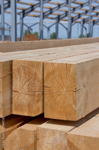 Fototapeta Wooden beams for steel structure for further construction. Metal frame for the installation of insulation panels. Construction of pre-fabricated buildings. obraz na płótnie