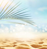 Summer beach background. Sand, palm leaf, sea and sky.