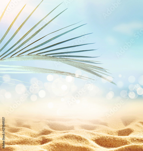 obraz lub plakat Summer beach background. Sand, palm leaf, sea and sky.