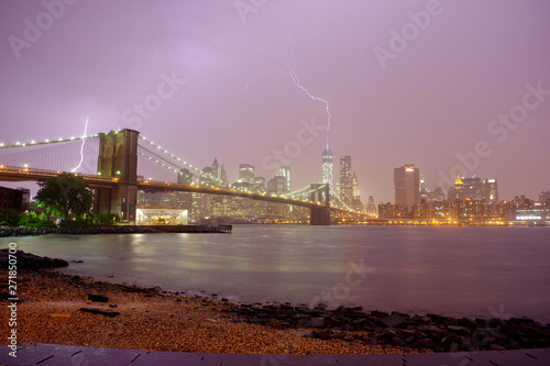 Fototapeta Brooklyn Bridge and Dramatic sky and lightning skyline of downtown New York obraz na płótnie