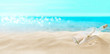 canvas print picture - View of the sandy beach. Bottle with a letter inside.